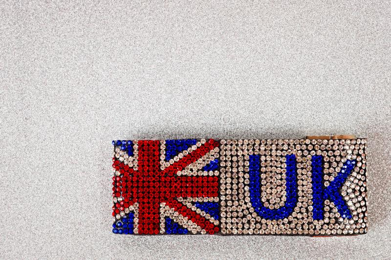 Great Britain flag bracelet inlaid with irregularly shaped stones with incredible brilliance.  stock image