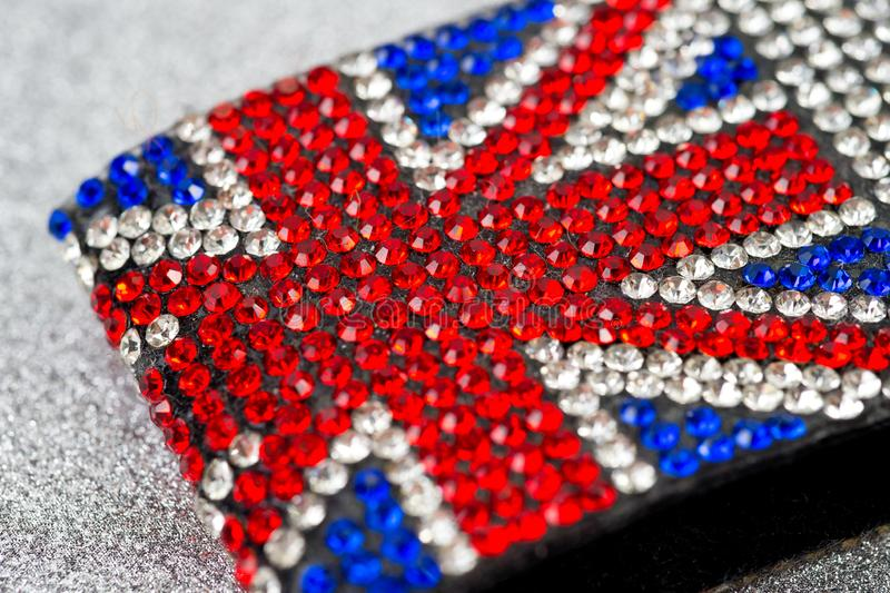 Great Britain flag bracelet inlaid with irregularly shaped stones with incredible brilliance.  royalty free stock photos