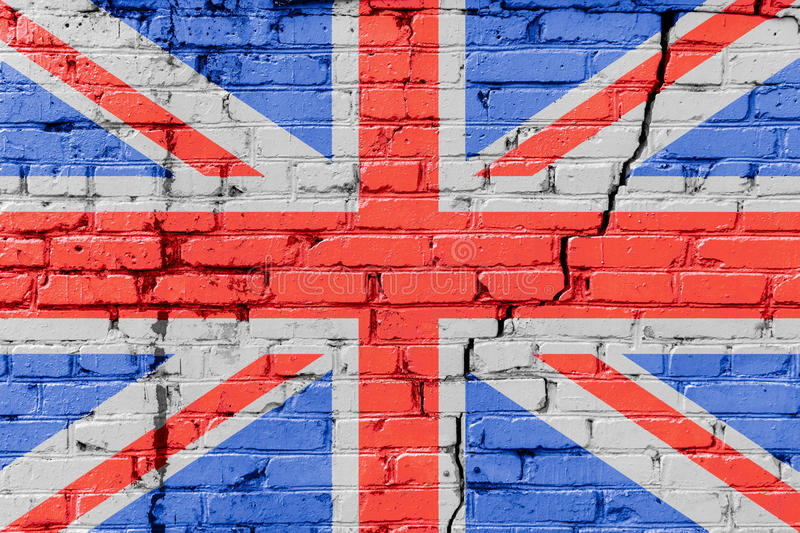 Great Britain flag painted on a brick wall. Flag of United Kingdom. Textured abstract background royalty free stock photography