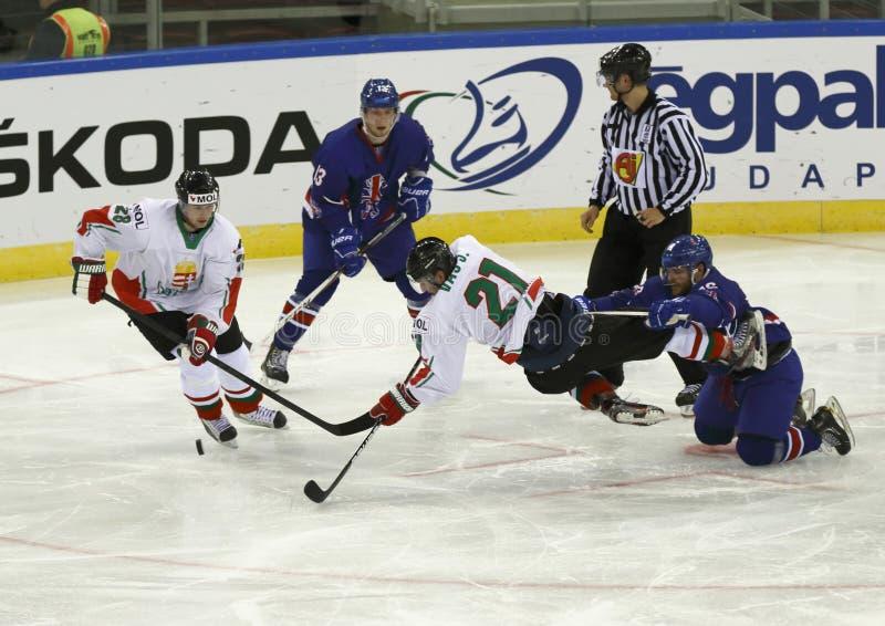 Great Britain vs. Hungary IIHF World Championship ice hockey mat. BUDAPEST - APRIL 14: Hungarian Janos Vas (21) is hooked by British Daniel Meyers during Great royalty free stock photo
