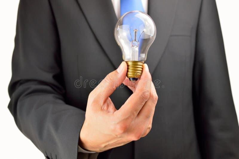 Great business idea. Business man showing a light bulb as idea work concept stock photo