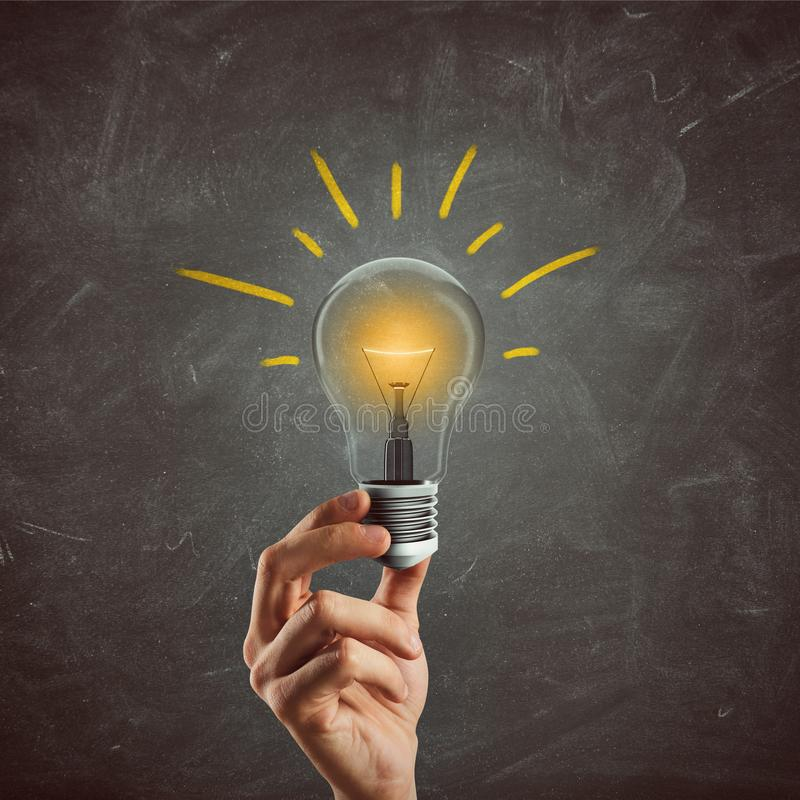 Great business idea. 3D Rendering. Businessman holding a light bulb. Great business idea concept. 3D Rendering stock photography