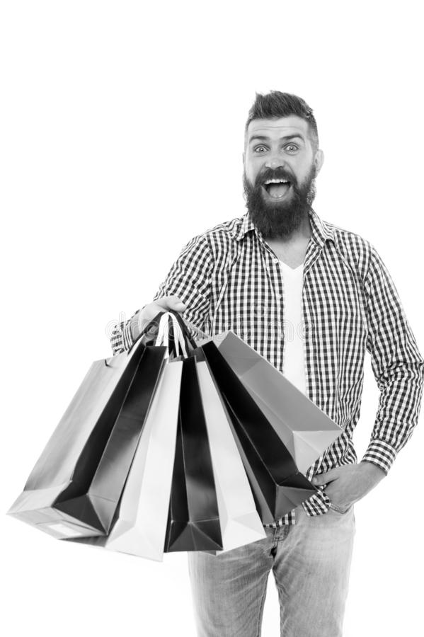 Great choices great purchases. Happy hipster holding purchases in paperbags isolated on white. Brutal bearded man stock image