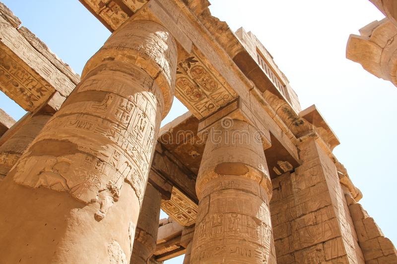 The great columns with carved hieroglyphs at the Karnak temple,  Thebes of Egypt in Luxor. Photo taken in egypt clear weather stock photography