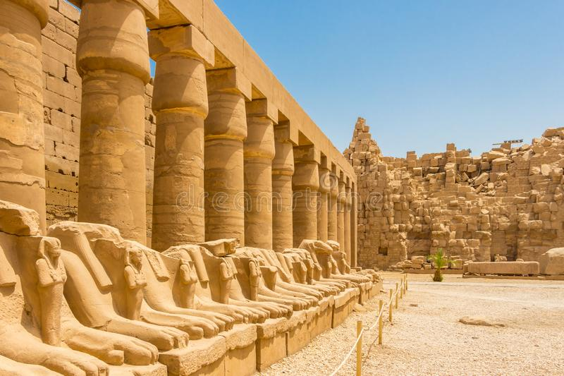 The great columns at the Karnak Temple and the Criosphinxes - Goats headed sphinxes, Egypt. The Temple of Amun is the largest religious building in the world and stock photography