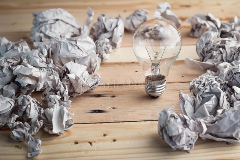 Great concept with crumpled office paper and light bulb stock images