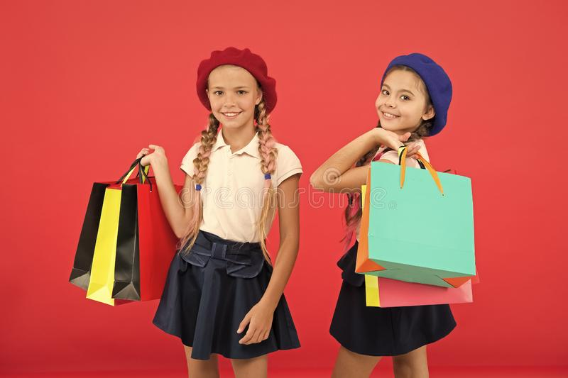 Great day for shopping. Children enjoy shopping red background. Visiting clothing mall. Discount and sale concept. Kids royalty free stock photography