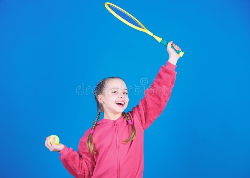 Great day to play. Athlete kid tennis racket on blue background. Active leisure and hobby. Tennis sport and. Entertainment. Girl adorable child play tennis stock photography