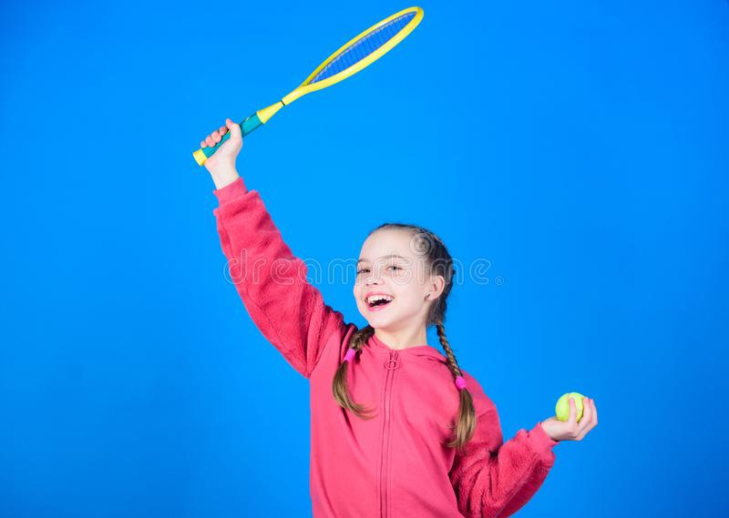 Great day to play. Athlete kid tennis racket on blue background. Active leisure and hobby. Tennis sport and. Entertainment. Girl adorable child play tennis stock image