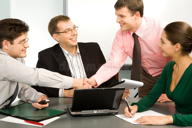 A great deal. Business people making a successful deal with the partners