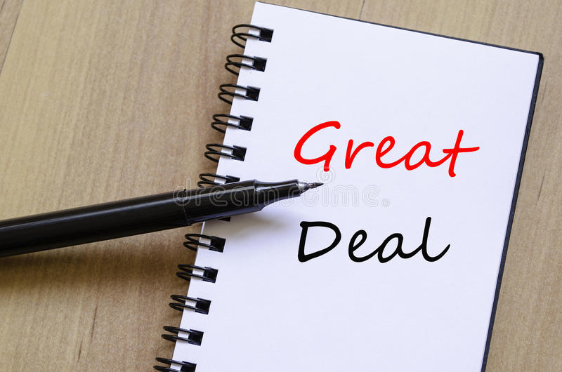 Great Deal Concept. White notepad and ink pen on the wooden desk Great Deal Concept stock images