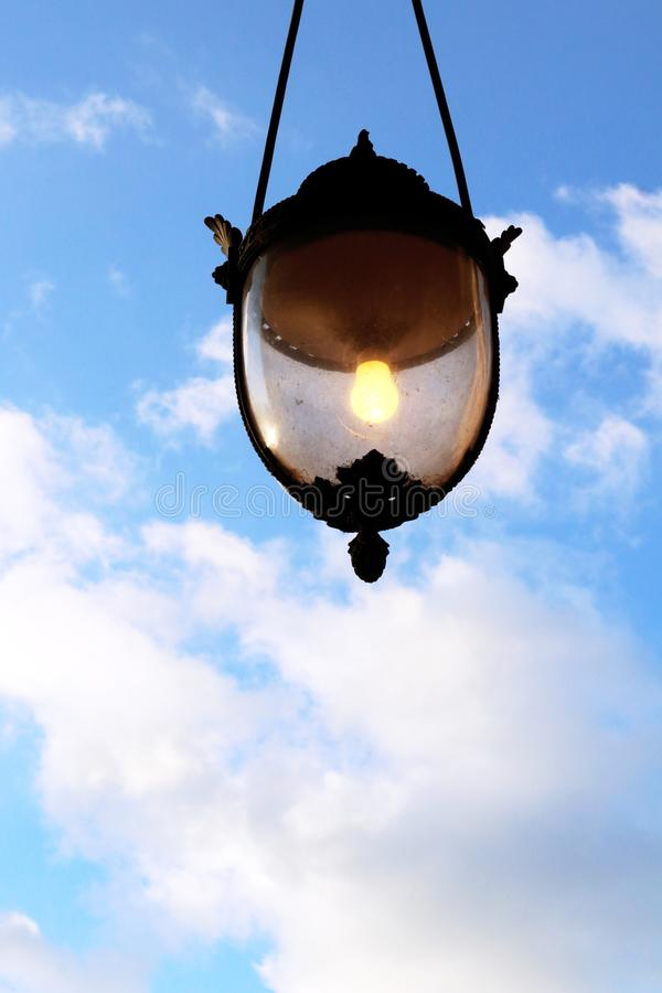 Great Idea Concept lamppost light bulb glowing in blue sky stock image