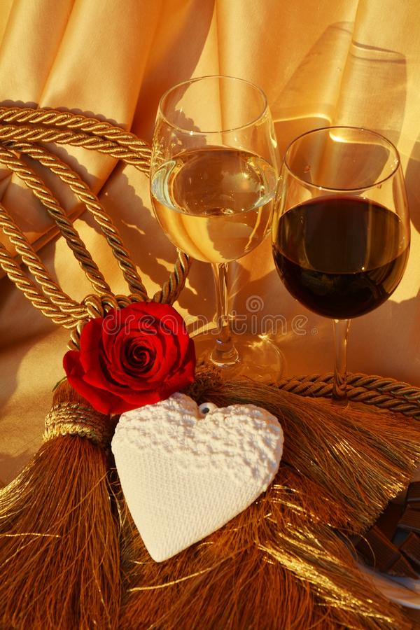 Great expectations. Two glasses of wine in an elegant golden background suggesting hope and expectations for love or relationships royalty free stock photos