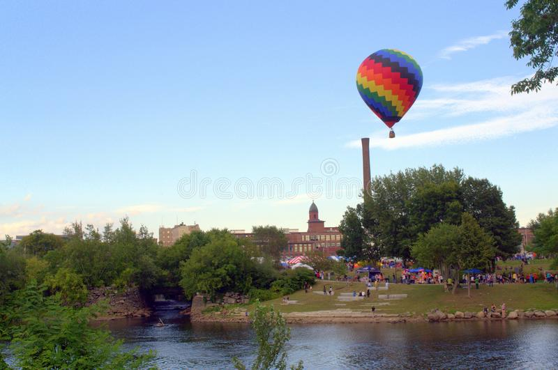 Great Falls Balloon Festival, Lewiston Auburn Maine. The festive balloon festival experiencing lift off of a colorful balloon royalty free stock image