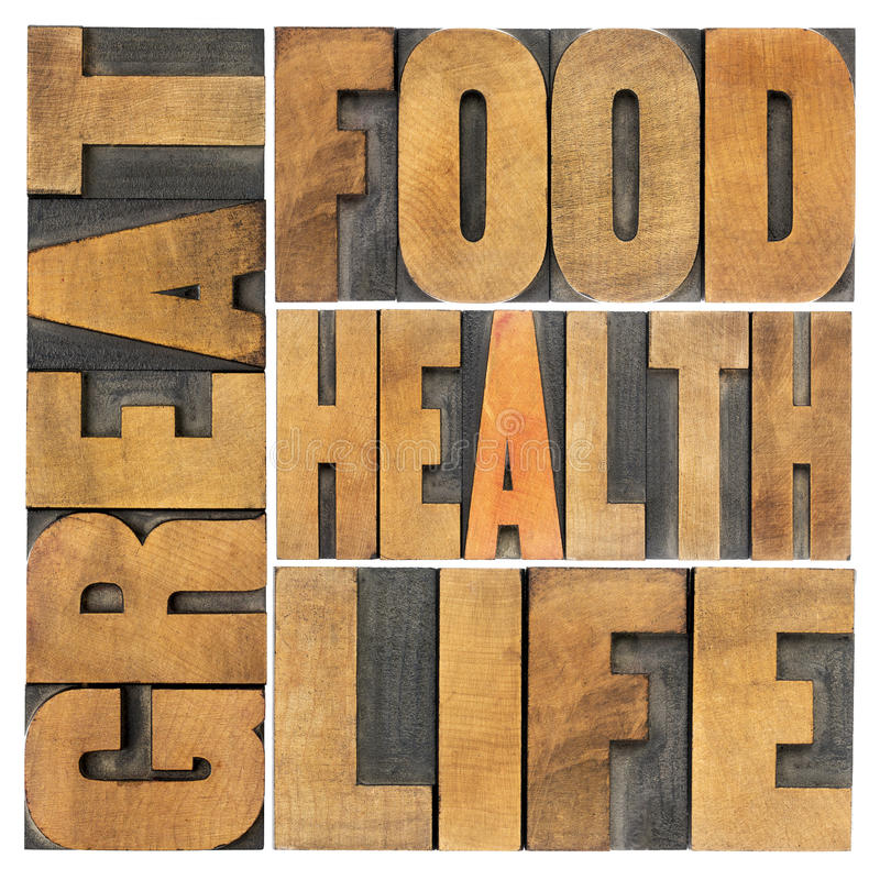 Great food, health and life. Healthy eating and lifestyle concept - isolated word abstract in letterpress wood type stock image