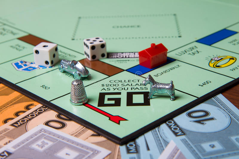 Great game. CALDWELL, IDAHO/USA - MARCH 16, 2015: Game pieces from game Monopoly sitting near the start royalty free stock images