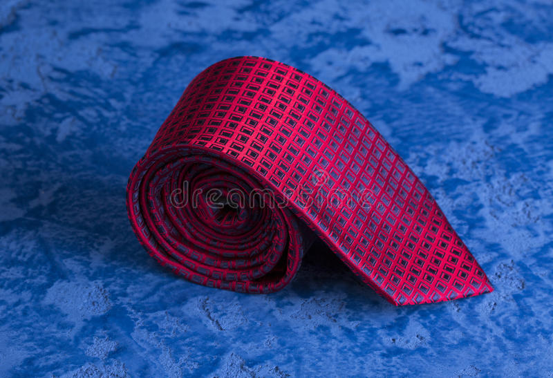 Great gift for a man on holiday. Blue tie of silk on a background of blue marble stock photography