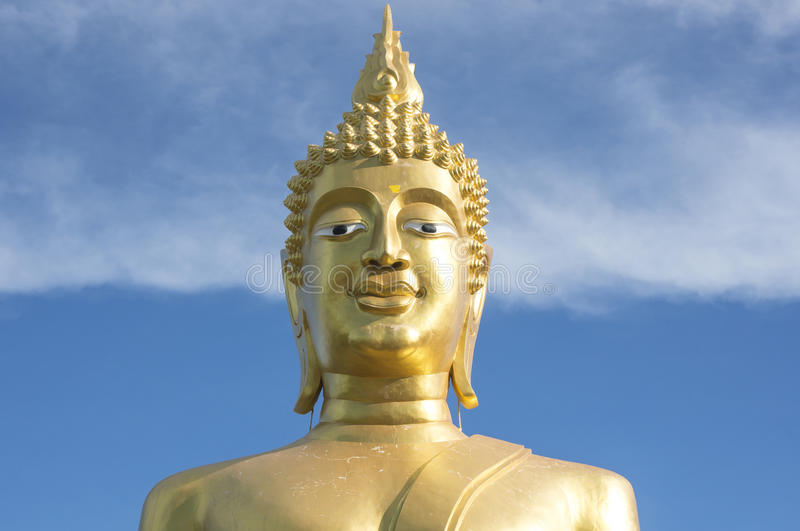 Great Golden Buddha statue in the temple with blue sky and white cloud royalty free stock photos