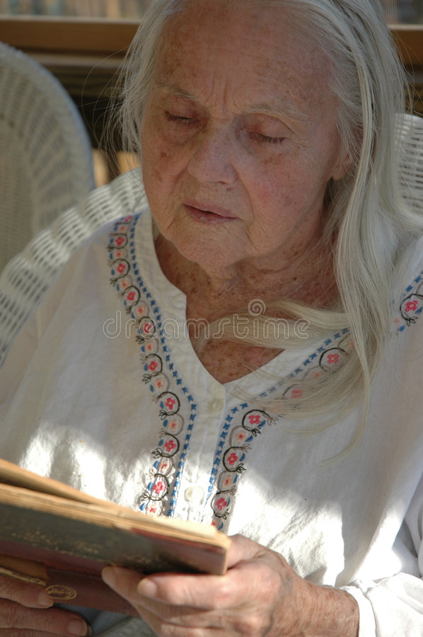 Great Grandmother With Old Book royalty free stock photos