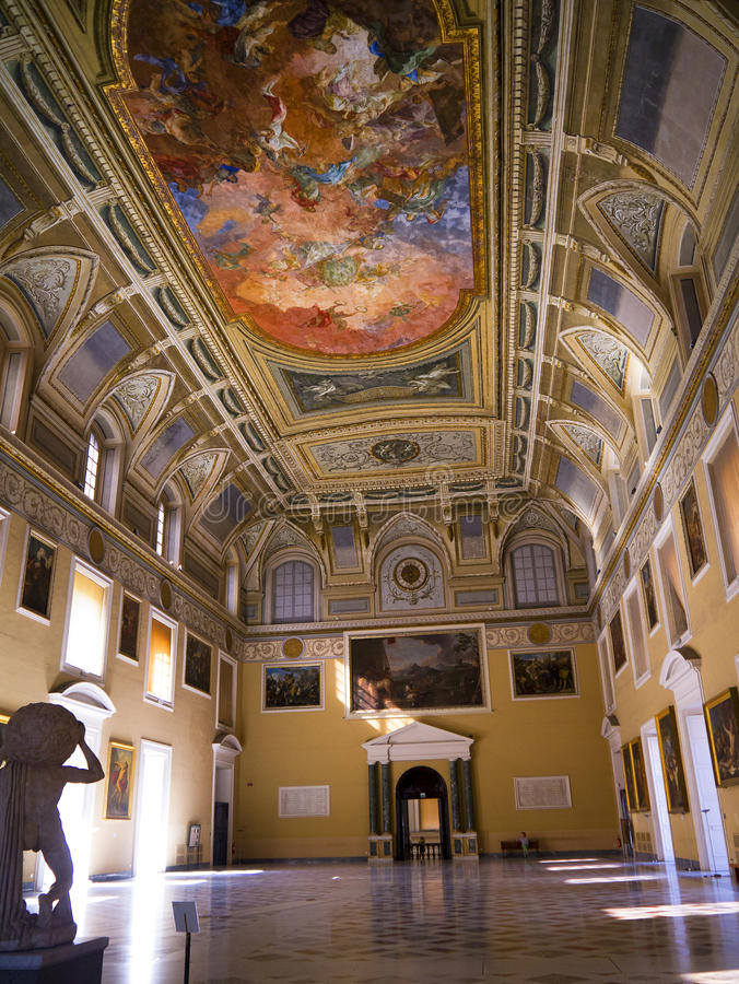 The Great Hall of the Museum. The Main Hall of the Naples Museum where the treasures of the buried city of Pompeii are displayed. The ornate ceiling is a stock images