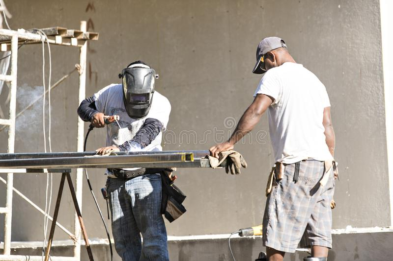 Great house construction african at work industry. A house construction african at work industry royalty free stock photos