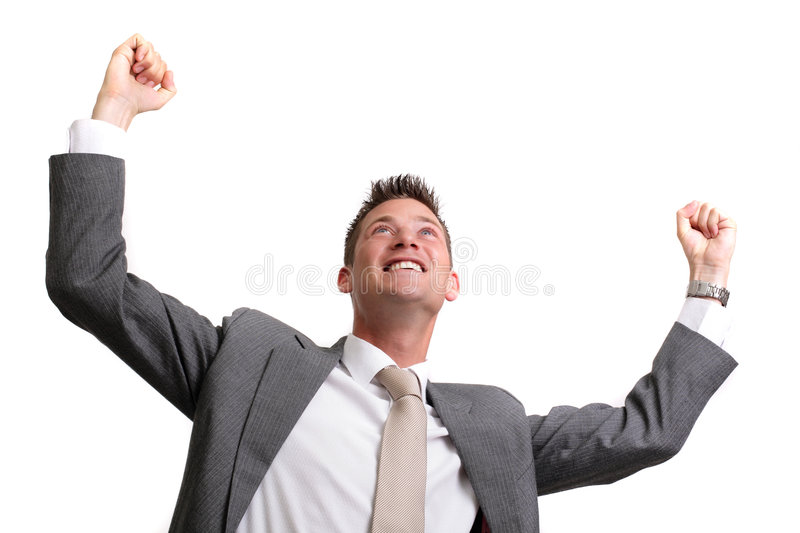 Great idea!. Young successful businessman with arms raised over white, plenty of copy space royalty free stock photos