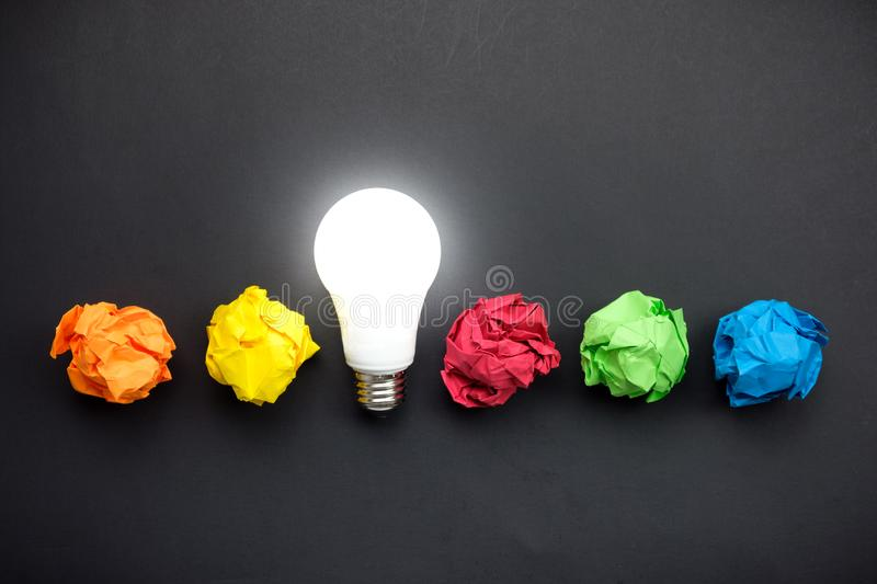 Great idea concept with crumpled colorful paper and light bulb royalty free stock images