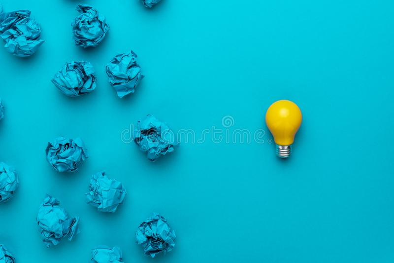Great idea concept with crumpled office paper and light bulb royalty free stock photo