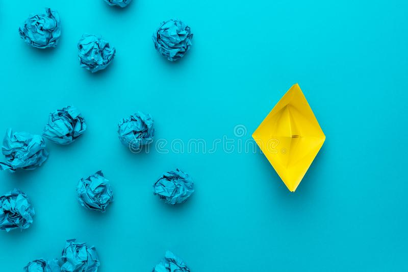 Great idea concept with crumpled office paper and yellow paper ship royalty free stock photo