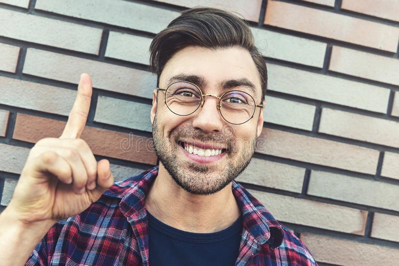 Surprised caucasian hipster with an idea or question pointing finger with happy face, number one royalty free stock photos