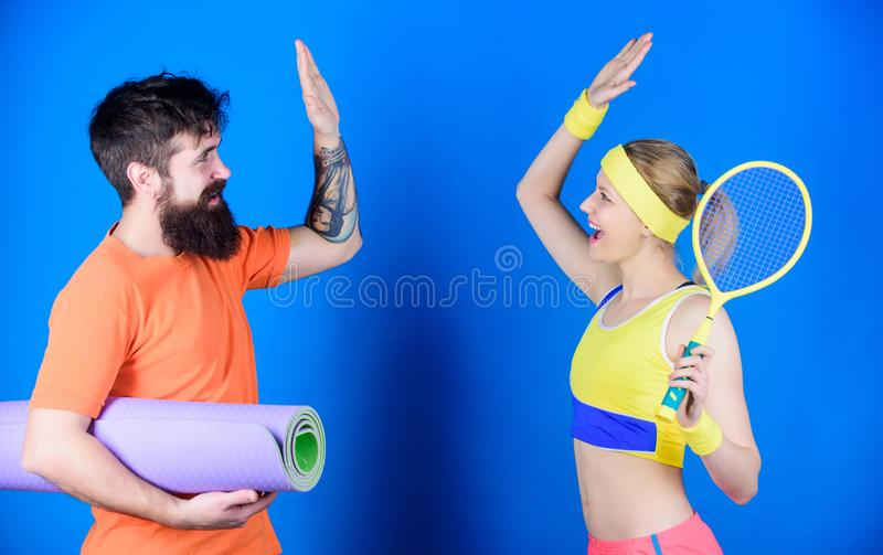 Great job. Best results. Athletic Success. Strong muscles and body. Sporty couple train with fitness mat tennis racket. Sport equipment. Happy women and royalty free stock photography
