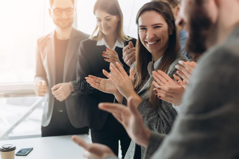 Great job! Successful business team is clapping their hands in modern workstation, celebrating the performance of new product royalty free stock images