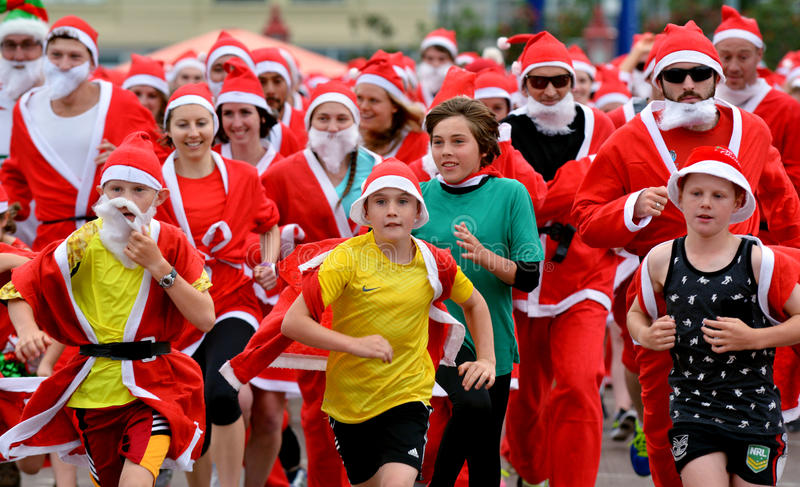 The Great KidsCan Santa Run Auckland Central. AUCKLNAD - DEC 02 2015:The Great KidsCan Santa free run.Thousands of people dressed as Santa Claus runs in the stock image