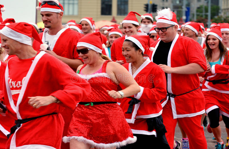 The Great KidsCan Santa Run Auckland Central. AUCKLNAD - DEC 02 2015:The Great KidsCan Santa free run.Thousands of people dressed as Santa Claus runs in the stock photo