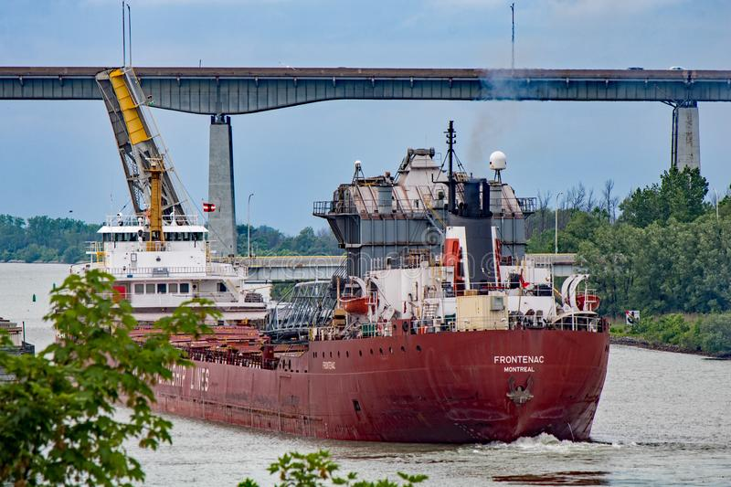 Great Lakes Freighter Going East Through The Welland Canal. A great lakes freighter heads toward Lake Ontario after transiting the final lock in the Welland stock image