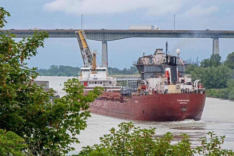 Great Lakes Freighter At The Welland Canal. A great lakes freighter heads toward Lake Ontario after transiting the final lock in the Welland Canal. The ship is stock images