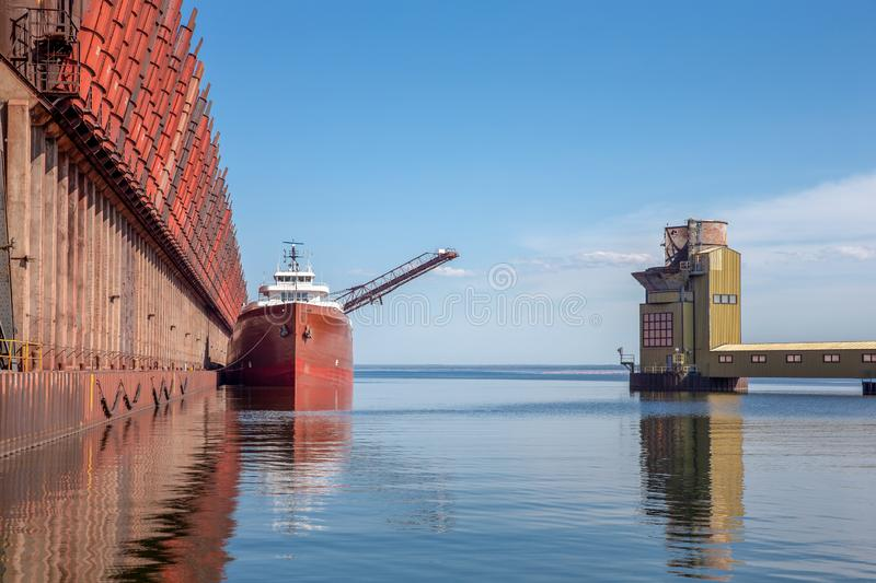 Great Lakes Freighter at Ore Dock. Great lakes freighter at an ore dock on Lake Superior. Concepts could include shipping, industry, transportation, other. Copy royalty free stock photo