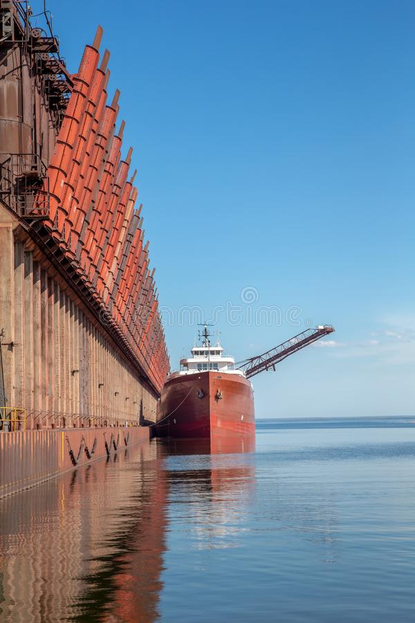 Great Lakes Freighter at Ore Dock. Great lakes freighter at an ore dock on Lake Superior. Concepts could include shipping, industry, transportation, other. Copy stock image