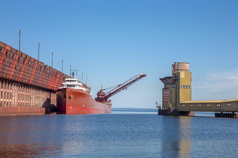 Great Lakes Freighter at Ore Dock. Great lakes freighter at an ore dock on Lake Superior. Concepts could include shipping, industry, transportation, other. Copy stock images