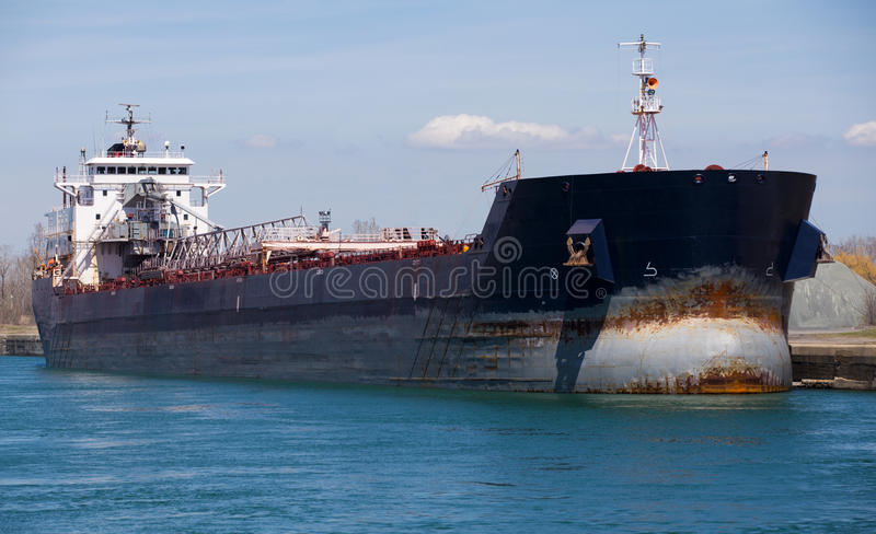 Great Lakes Freighter Ship at Dock. Photograph of Great Lakes freighter at dock taking on a shipment royalty free stock images