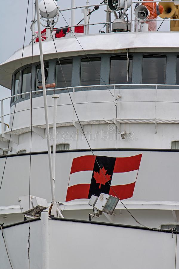 Great Lakes Freighter Wheelhouse Close-Up. A great lakes freighter heads toward Lake Ontario after transiting the final lock in the Welland Canal. The ship is stock photo