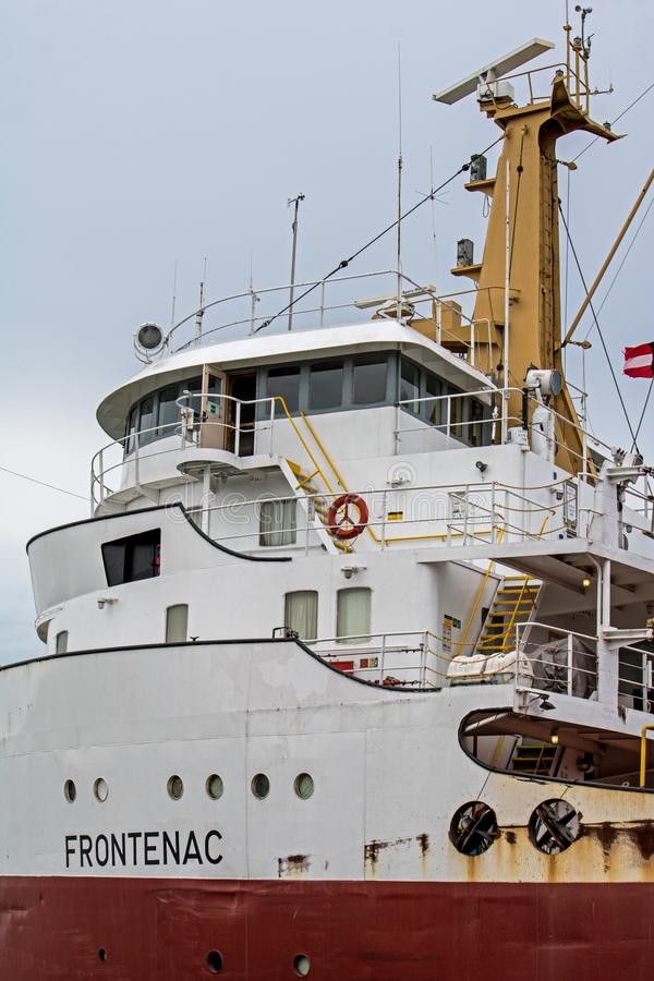 Great Lakes Freighter Wheelhouse At The Welland Canal. A great lakes freighter heads toward Lake Ontario after transiting the final lock in the Welland Canal stock image