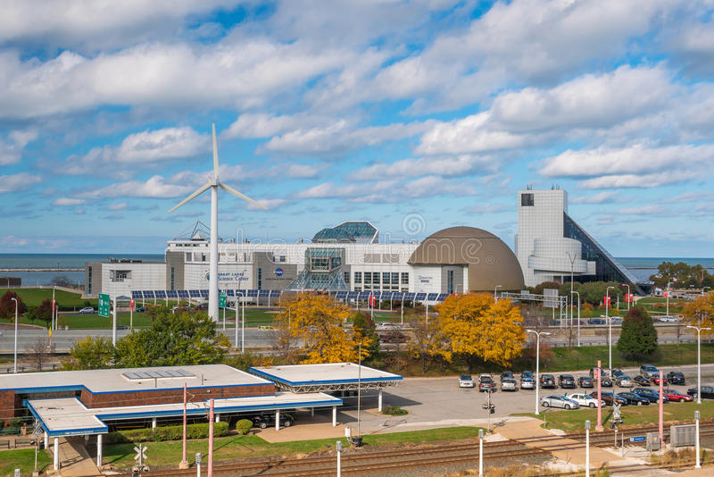 Great Lakes Science Center in Cleveland Ohio. CLEVELAND, OH - NOVEMBER 4: Downtown Cleveland skyline and Great Lakes Science Center in Ohio USA on November 4 royalty free stock photo