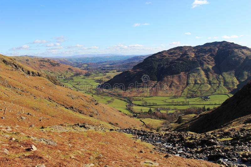Great Langdale valley from Stickle Ghyll, Cumbria. View from the footpath alongside Stickle Ghyll down into Great Langdale (valley) with Windermere (lake) just stock photo