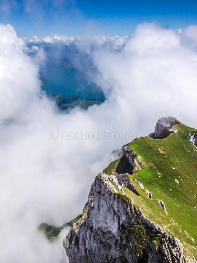 Great Majestic Dreamy Landscape View of Natural Swiss Alps from Mount Pilatus Peak. Breathtaking view of Steep Cliff and fog stock photo