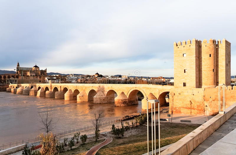 Great Mosque and Roman Bridge at Dusk in Cordoba. The Great Mosque as seen from The Roman Bridge and the Calahorra Tower on the guadalquivir river in Cordoba royalty free stock photo