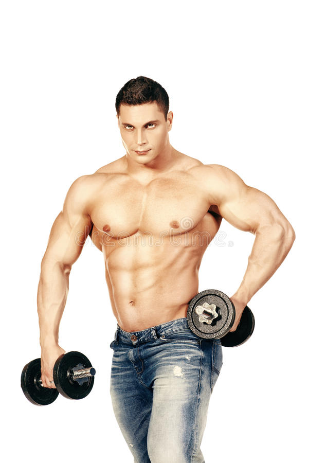 Great muscles. Portrait of a handsome muscular bodybuilder posing with dumbbell. Isolated over white background royalty free stock photo