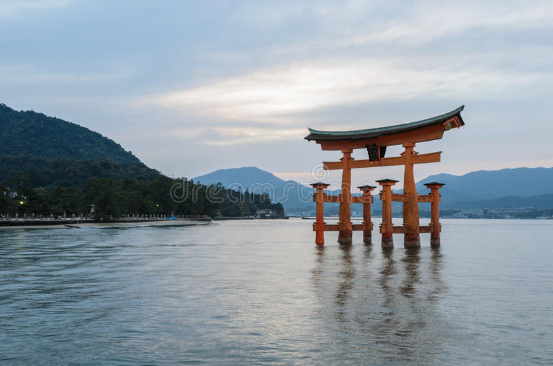 The great O-Torii of Itsukushima Shrine in Miyajima, Hiroshima. The stunning sunset view of famous floating torii gate of the Itsukushima Shrine in Miyajima stock photography