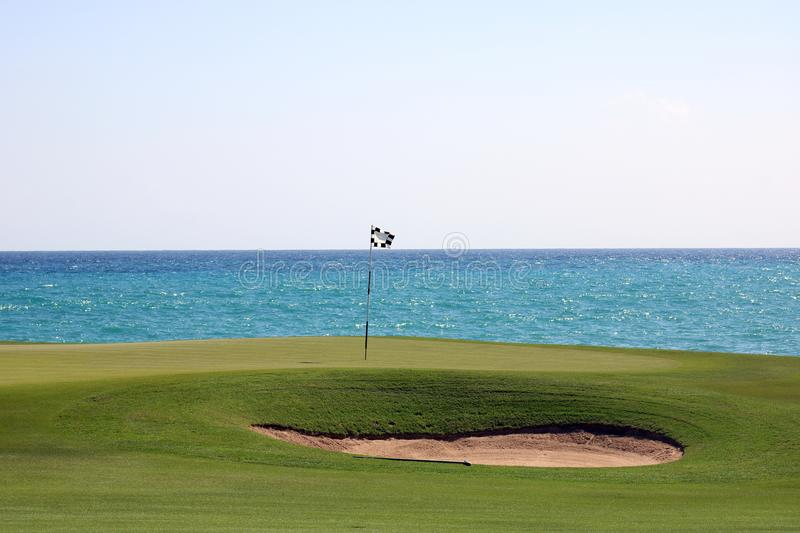 Great ocean colors Caribbean beach golf. Great ocean colors Caribbean beach at island with golf sand trap royalty free stock images