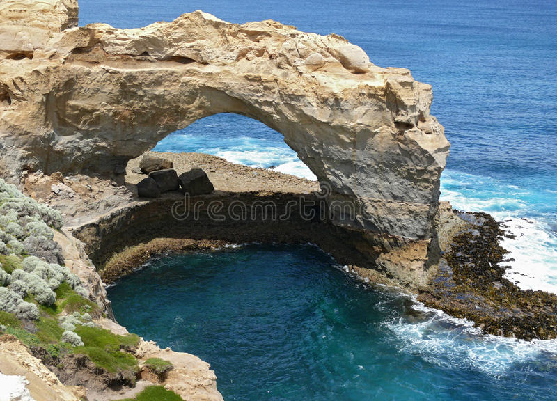 Great Ocean Road, arch. The rocky arch and surf. Great Ocean Road, Australia, Victoria, National park royalty free stock images